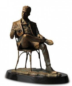 man sitting in chair  - bronze